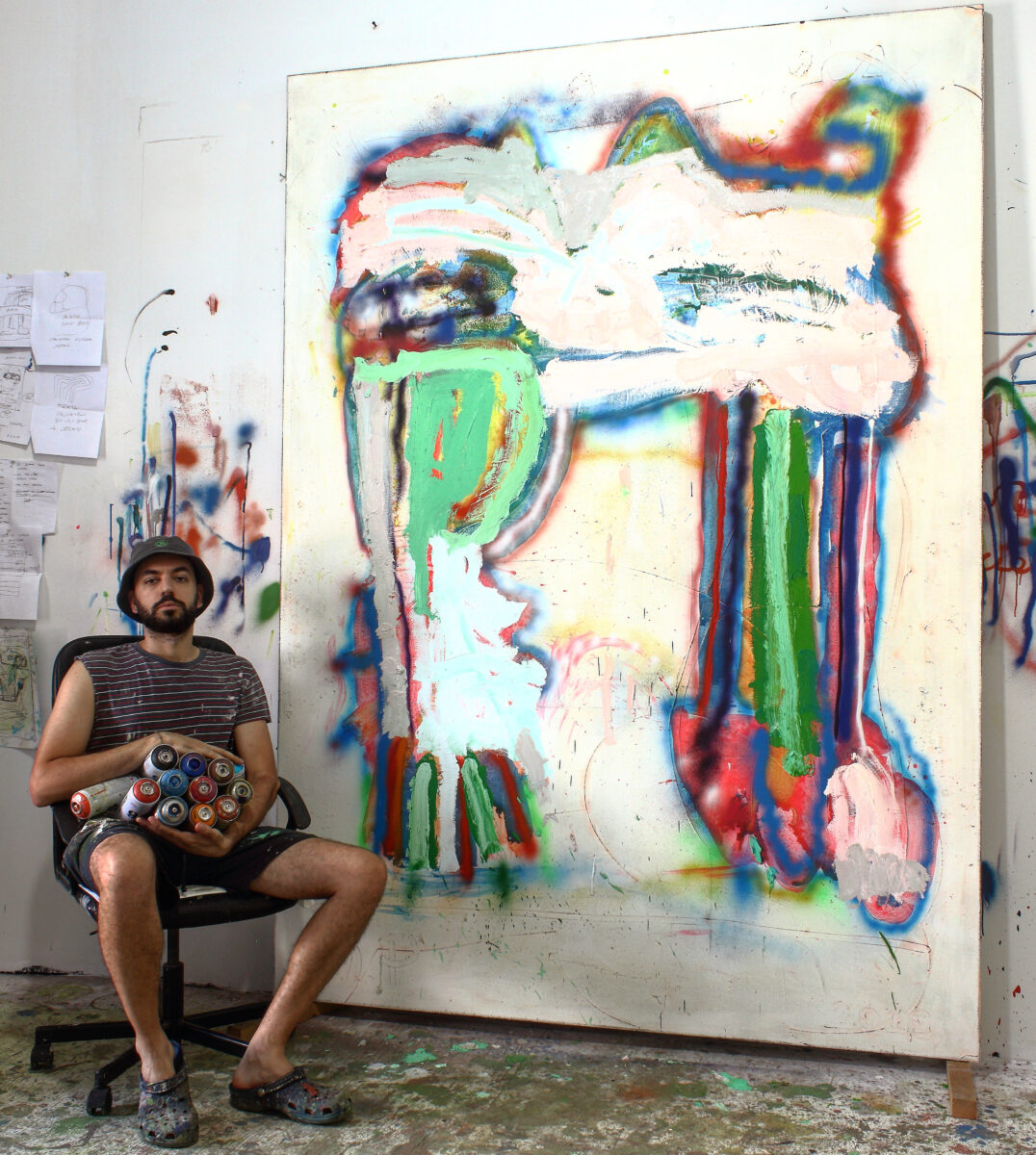 photograph of Marco Pariani in his Brooklyn studio with the painting Sometimes Legs, 2019